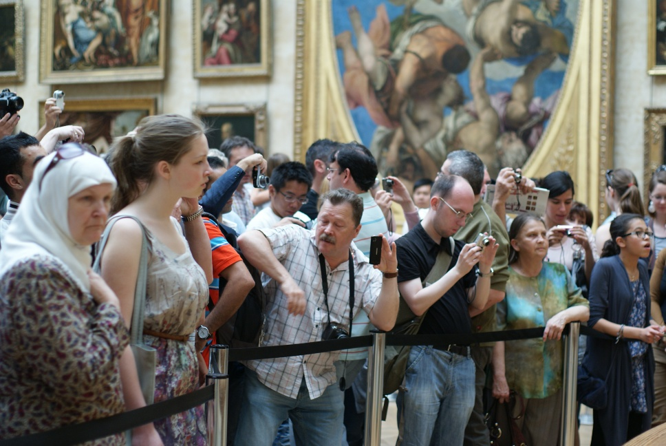 The scrum in front of the Mona Lisa