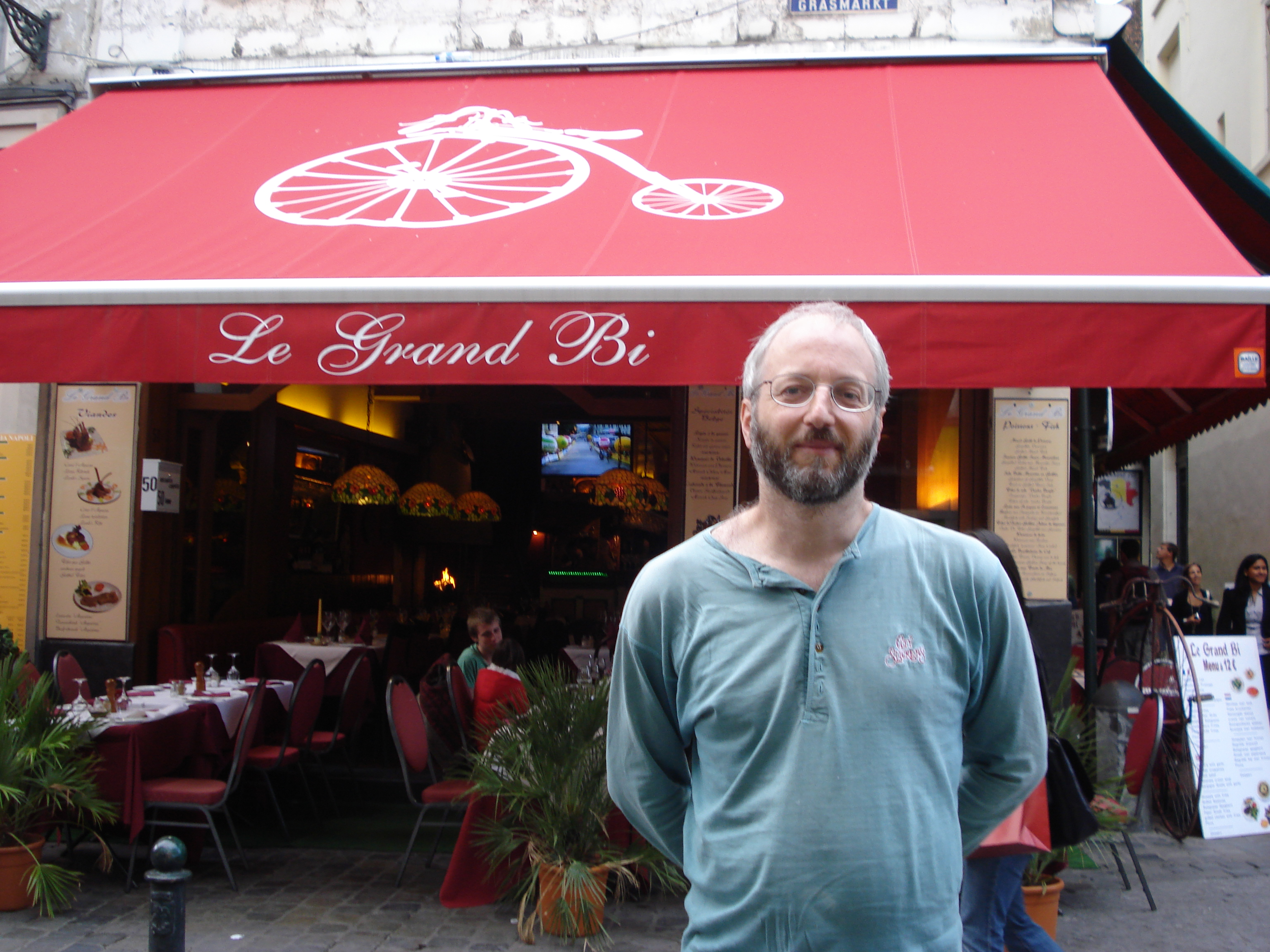 Ian in front of a Brussels restaurant called Le Grand Bi